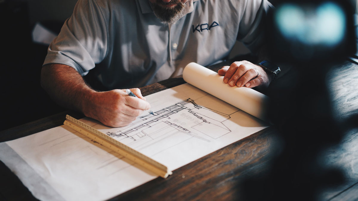 A commercial remodeling contractor draws up plans.