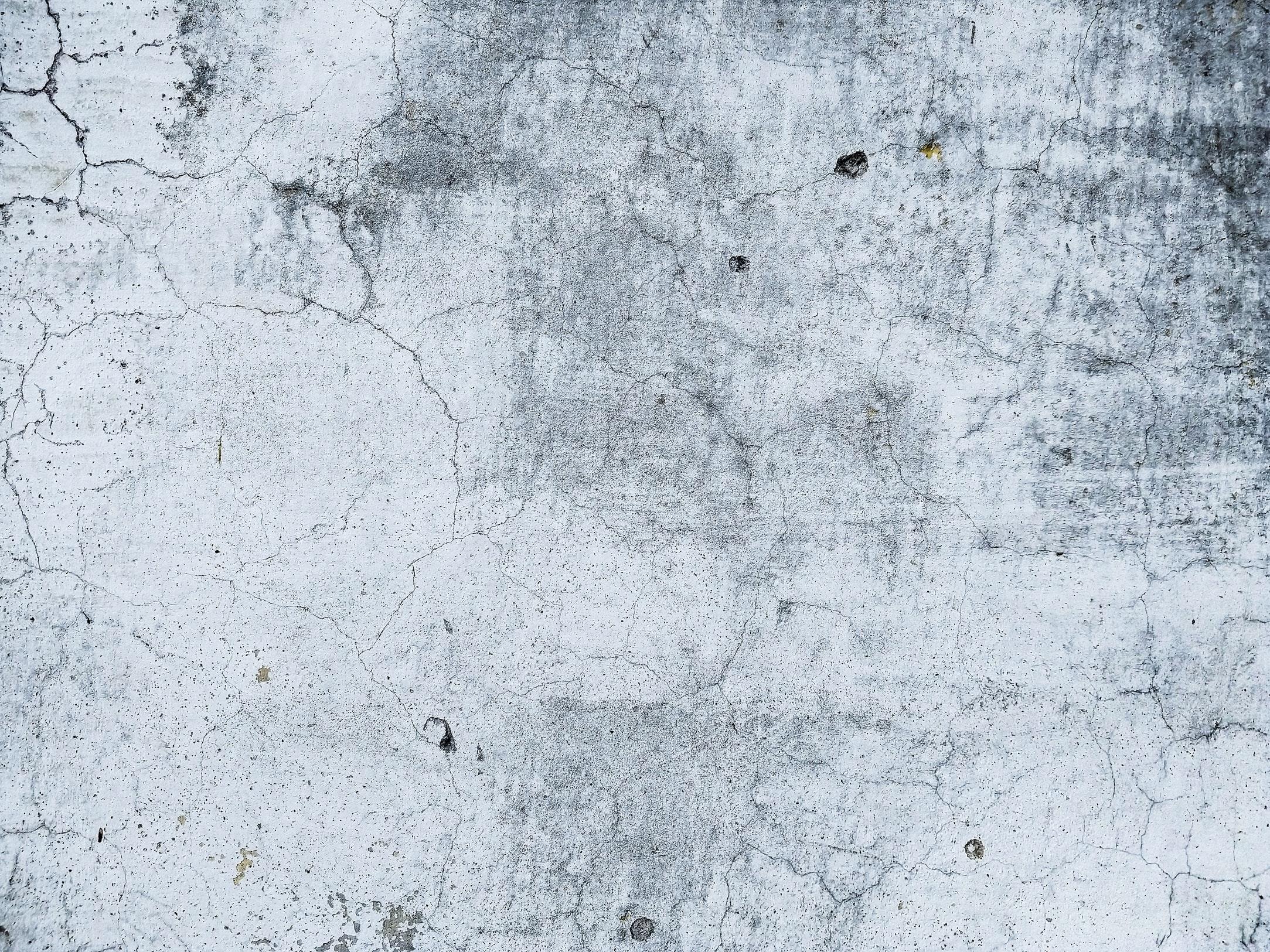 Cracked, grey concrete.