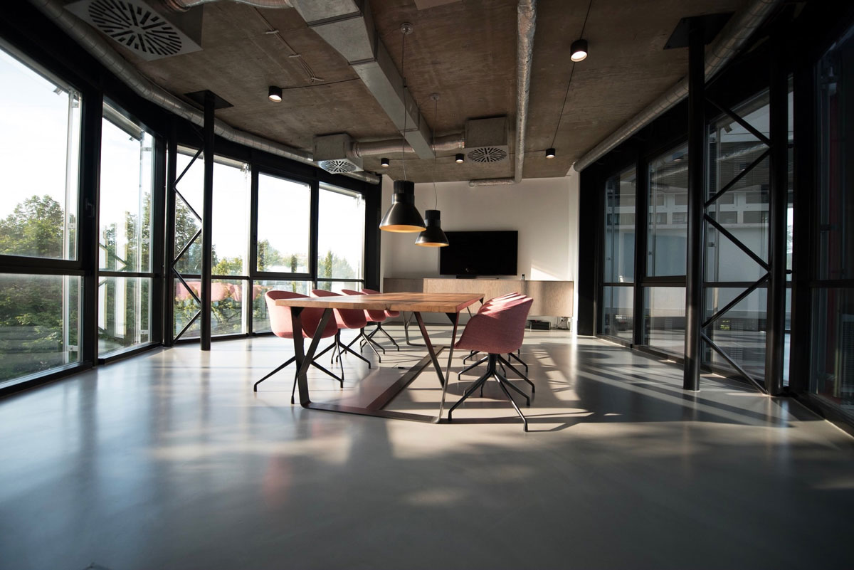 An empty industrially designed, modern space in an office building.