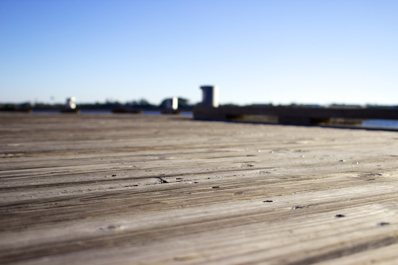 Close up photo of an old wood deck.
