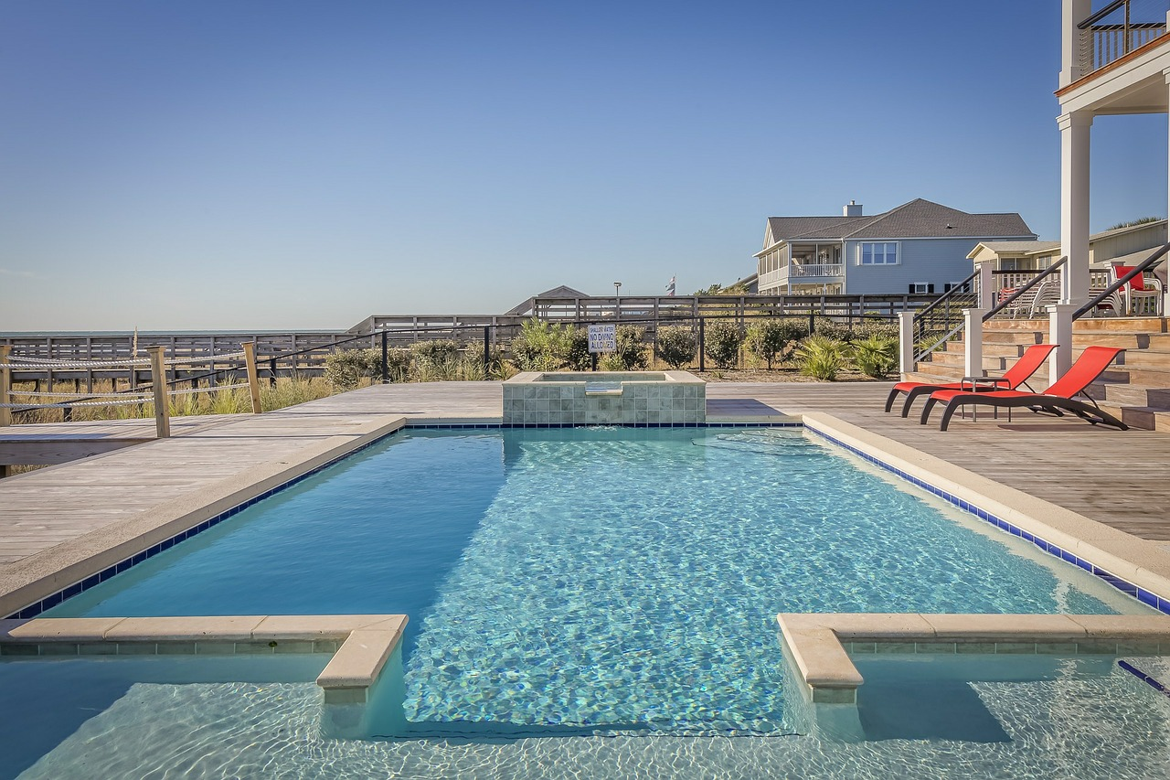 A luxurious outdoor swimming pool on a large deck