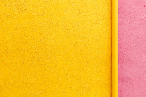 Bright yellow and pink striped wall